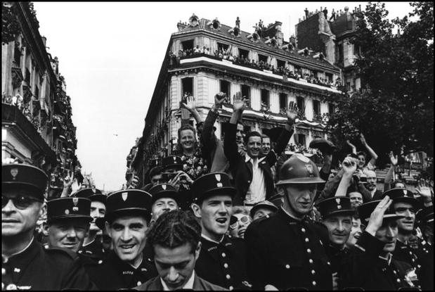 Crowds throng the Champs Elysees during the celebrations on the 26th August 1944 for the liberation of Paris.