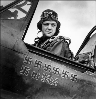 The American fighter ace, Pilot LARDNER in the cockpit, with swastikas showing how many enemy planes he had shot down.